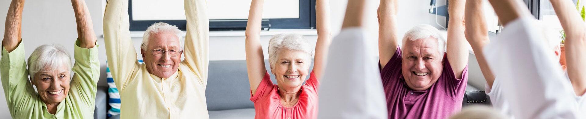 group of seniors exercising senior living wellness program