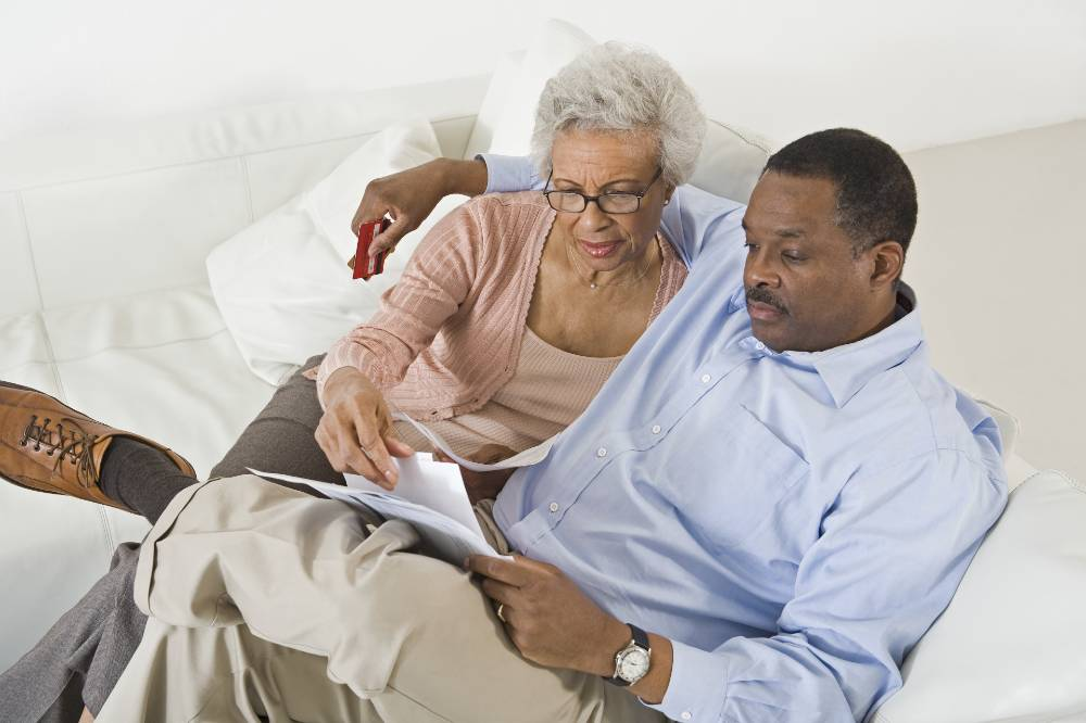 senior couple looking at paperwork together